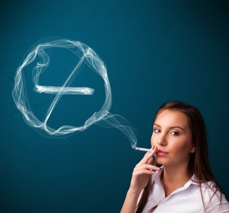 inhale: Pretty young lady smoking unheathy cigarette with no smoking sign Stock Photo