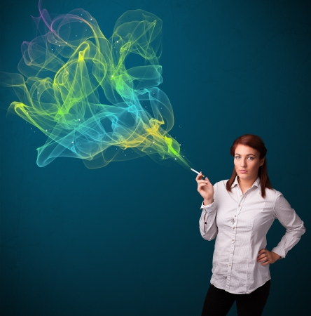 Pretty young lady smoking cigarette with colorful smoke Stock Photo - 16746806