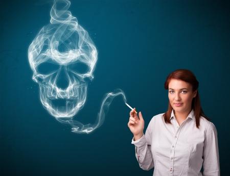 Pretty young woman smoking dangerous cigarette with toxic skull smoke Stock Photo - 16746851