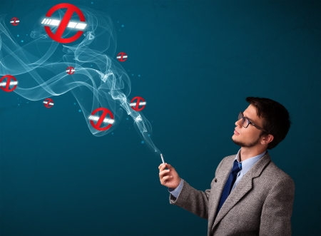 Attractive young man smoking dangerous cigarette with no smoking signs Stock Photo - 16741948