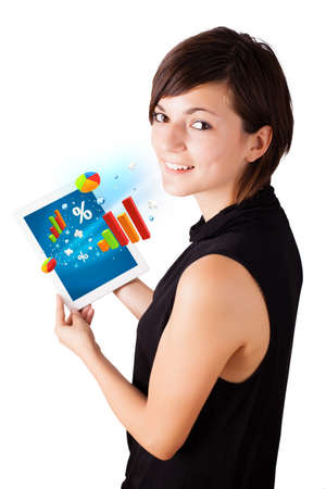 Young business woman looking at modern tablet with colourful diagrams Stock Photo - 16751440