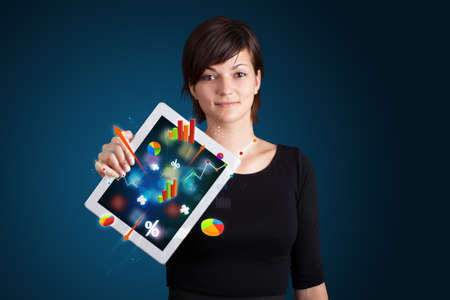 woman tablet: beutiful woman holding modern tablet with colorful diagrams and graphs