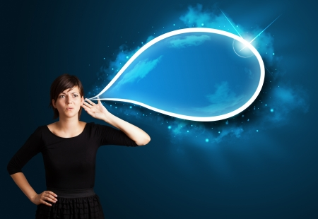 Young business woman with modern speech bubble photo
