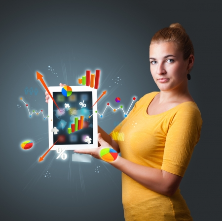 beutiful woman holding modern tablet with colorful diagrams and graphs Stock Photo - 16746910