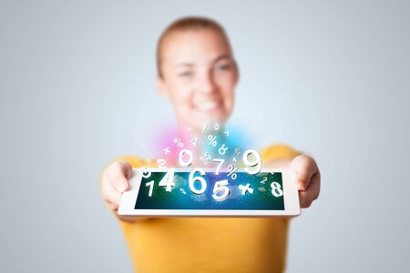 Beautiful young woman holding tablet with numbers Stock Photo - 16747218