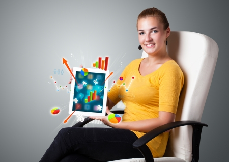 beutiful woman holding modern tablet with colorful diagrams and graphs Stock Photo - 16973148