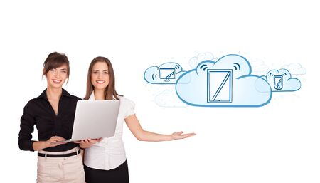Beutiful young women presenting modern devices in clouds isolated on white Stock Photo - 16751140