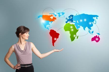 intercontinental: Beautiful young woman presenting colorful world map