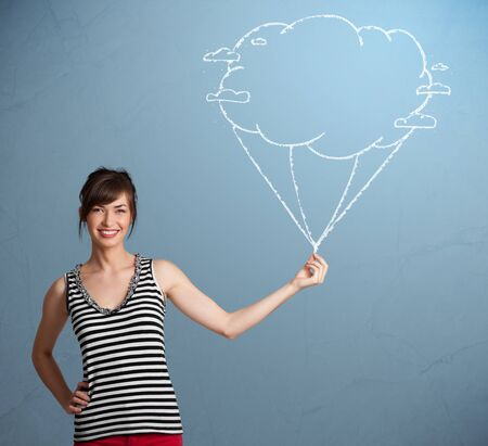 Pretty young lady holding a cloud balloon drawing Stock Photo - 16973117