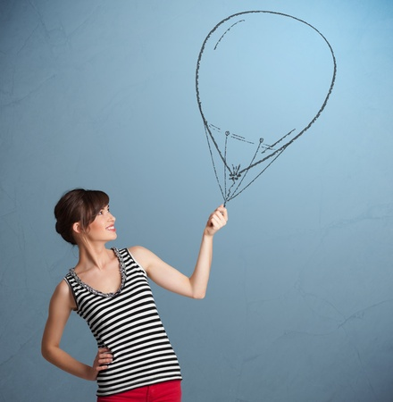 Beautiful young woman holding balloon drawing Stock Photo - 16973167
