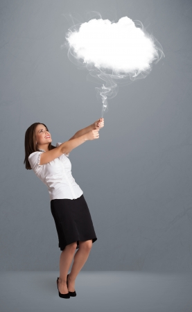 Beautiful young woman holding cloud Stock Photo - 16973153