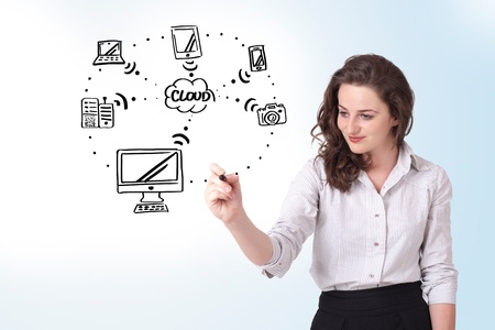 Young woman drawing a cloud computing on white whiteboard Stock Photo - 16973056