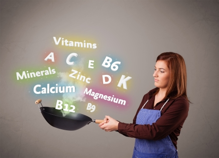 Pretty young woman cooking vitamins and minerals Stock Photo - 17340196