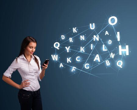Beautiful young woman typing on smartphone with high tech 3d letters comming out Stock Photo - 17340162
