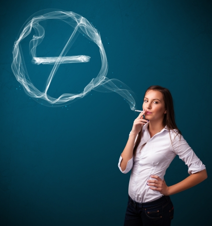 cigarette smoke: Pretty young lady smoking unheathy cigarette with no smoking sign Stock Photo