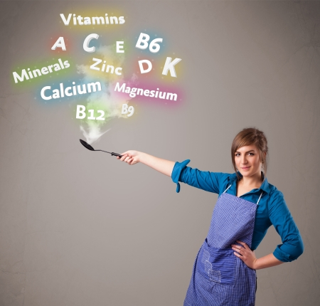 Pretty young woman cooking vitamins and minerals Stock Photo - 17340133