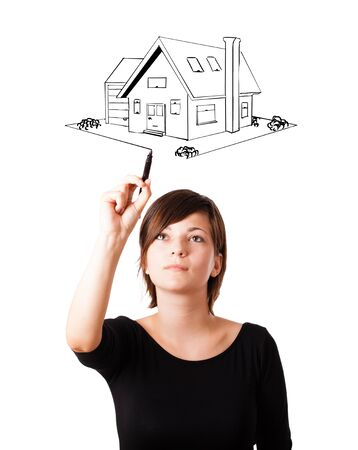 country girl: Young woman drawing a house on whiteboard isolated on white Stock Photo