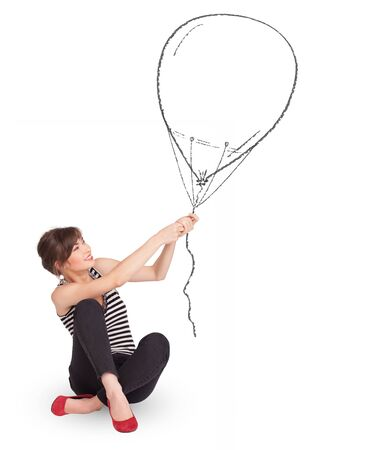 Pretty young woman holding balloon drawing photo