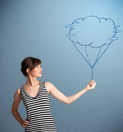 Pretty young lady holding a cloud balloon drawing photo