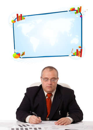 Businessman sitting at desk with copy space, isolated on white photo