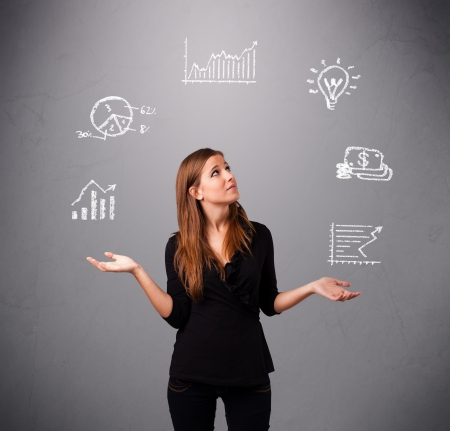 beautiful young woman standin and juggling with statistics and graphs Stock Photo - 17563473