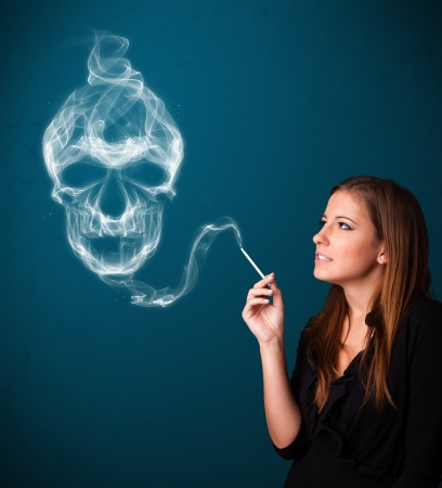 Pretty young woman smoking dangerous cigarette with toxic skull smoke Stock Photo - 17563567