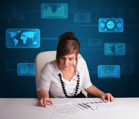 Businesswoman doing paperwork with futuristic digital backgroung Stock Photo - 17563520