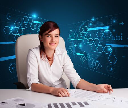 Young businesswoman doing paperwork with futuristic background Stock Photo - 17563521