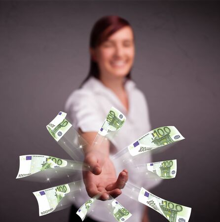 Pretty young woman standing and throwing money Stock Photo - 17563507