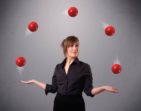 pretty young girl standing and juggling with red balls Stock Photo - 17563474