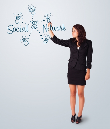 Young woman draving social network theme on whiteboard Stock Photo - 17563559