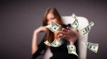 Beautiful young girl throwing money Stock Photo - 17740121