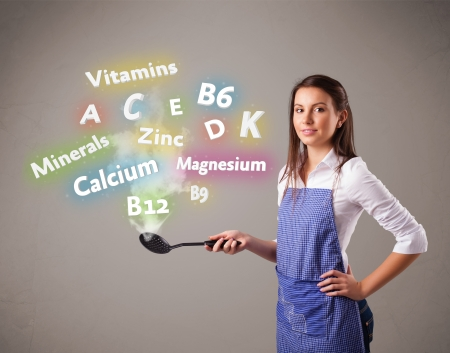Pretty young woman cooking vitamins and minerals Stock Photo - 17738179