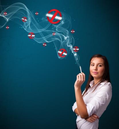 Beautiful young woman smoking dangerous cigarette with no smoking signs Stock Photo - 17737858