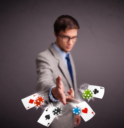 Handsome young man playing with poker cards and chips Stock Photo - 17738409