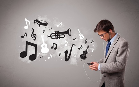 attractive young man singing and listening to music with musical notes and instruments getting out of his mouth Stock Photo