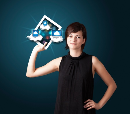 Beautiful young woman holding tablet with modern devices in clouds Stock Photo - 17738533