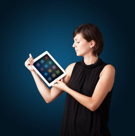 beautiful woman holding modern tablet with colorful icons photo