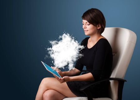 Young business woman looking at modern tablet with abstract cloud Stock Photo - 17739768