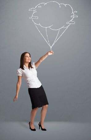 Pretty young lady holding a cloud balloon drawing Stock Photo - 17737893