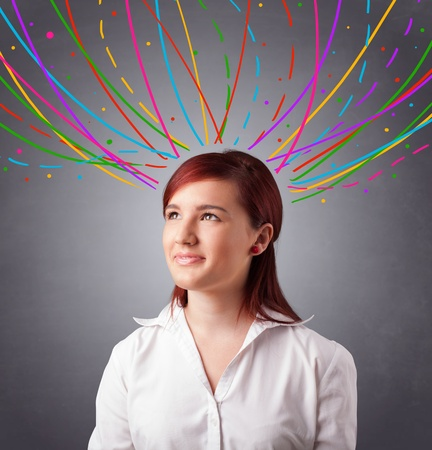Pretty young girl thinking with colorful abstract lines overhead Stock Photo - 17784566