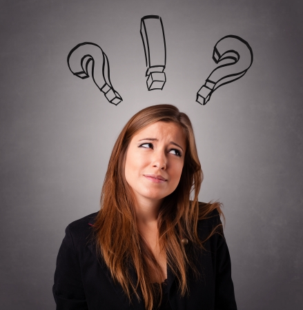 Beautiful young lady thinking with question marks overhead Stock Photo - 17784544
