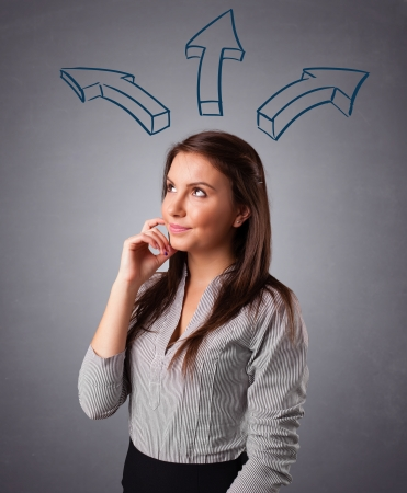 Beautiful young lady thinking with arrows overhead Stock Photo - 17784508