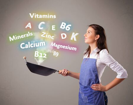 Pretty young woman cooking vitamins and minerals Stock Photo - 17786045