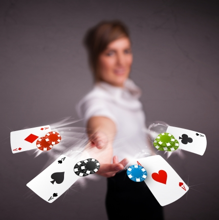 card game: Pretty young woman playing with poker cards and chips  Stock Photo