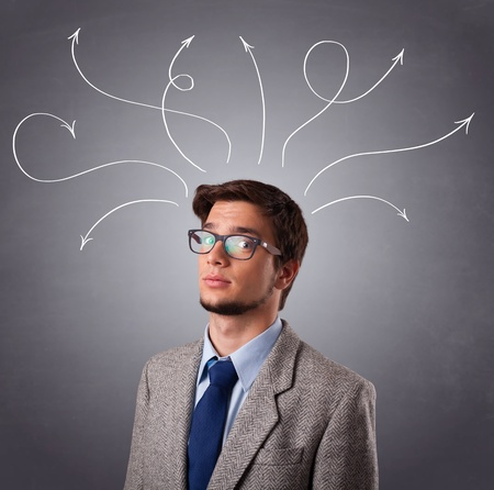 Attractive young man thinking with arrows overhead Stock Photo - 17784548