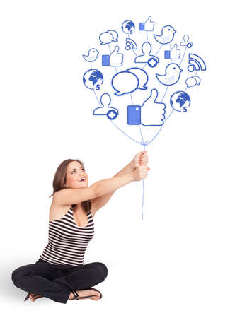 Happy young lady holding social icon balloon Stock Photo - 17784591