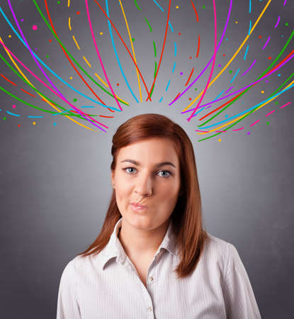 Pretty young girl thinking with colorful abstract lines overhead Stock Photo - 17895091