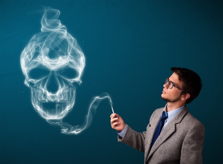 Handsome young man smoking dangerous cigarette with toxic skull smoke Stock Photo - 17895118