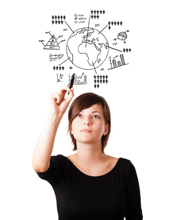 Young woman drawing globe with various diagrams isolated on white photo